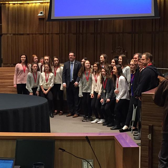 @mayorcamguthrie hands out medals to the Guelph Gryphons Girls U14 Red Rep team for winning the Ontario Soccer Association's Indoor Cup to kick off #Guelph city council tonight.